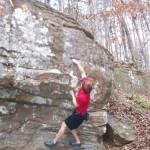 student rockclimbing