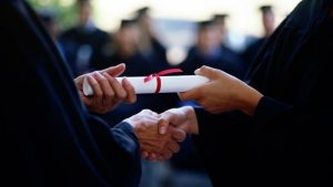 diploma being handed from professor to graduate