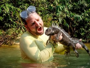 Mike Steinberg holding an iguana